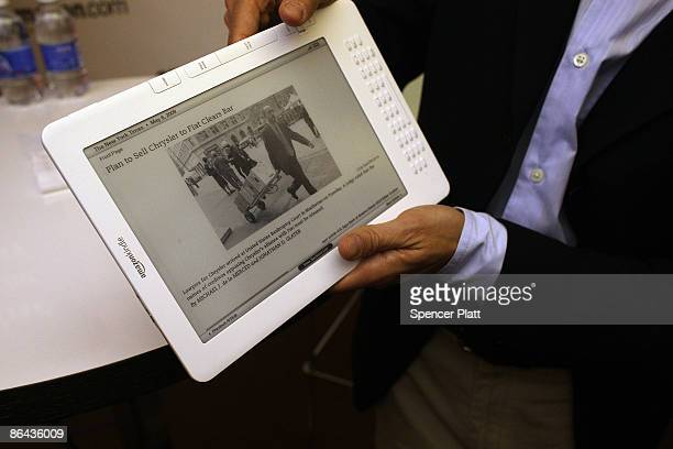 Members of the media are given a demonstration of the new Kindle DX which he unveiled at a press conference by Amazon CEO Jeff Bezos at the Michael...