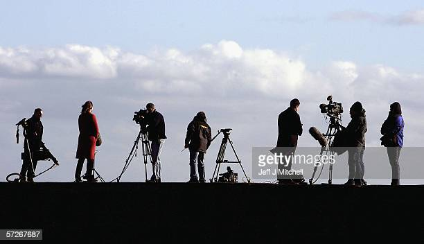 Members of the media are seen in Cellardyke harbour on April 6 2006 in Cellardyke Scotland Authorities in Scotland confirmed test results from a dead...