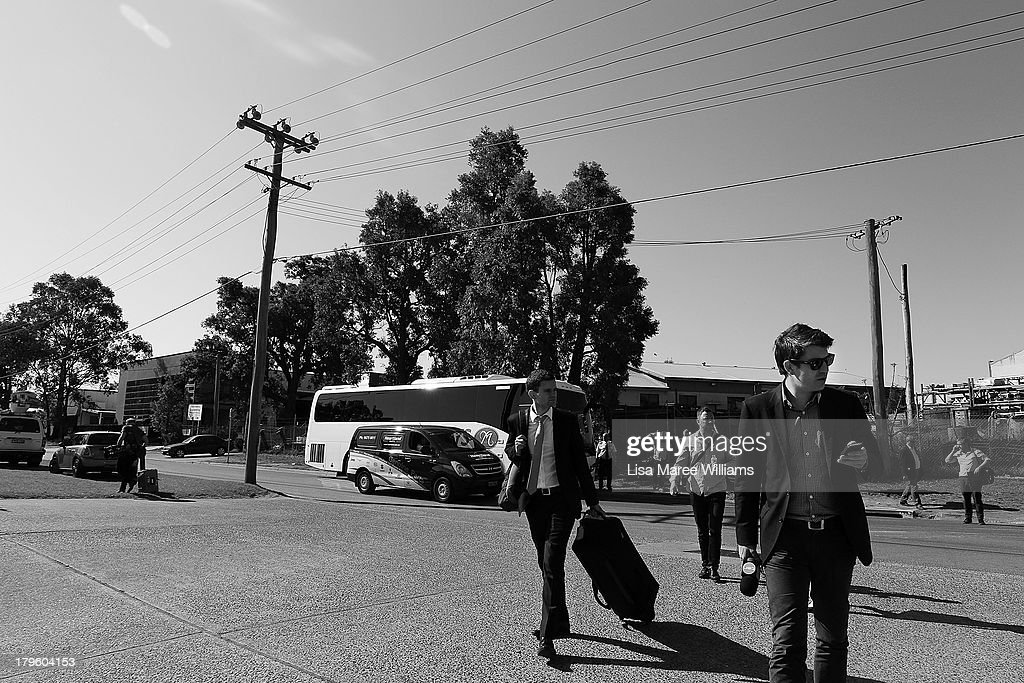 Members of the media arrive at Corinthian Doors factory in preparation for Tony Abbott's tour of the factory on September 4, 2013 in Sydney, Australia. With just three days of campaigning before Saturday's Federal Election it looks increasingly unlikely that the Australian Labor Party will hold on to government as the Liberal-National Party coalition pulls ahead in polling.