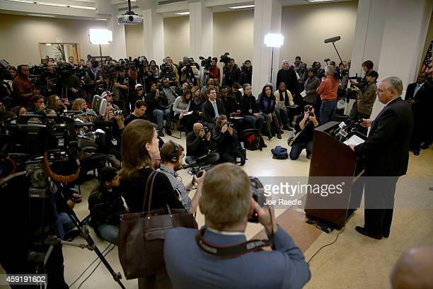 Members of the media attend a press conference by Missouri Governor Jay Nixon after his announcing of a 16member Ferguson Commission on November 18...