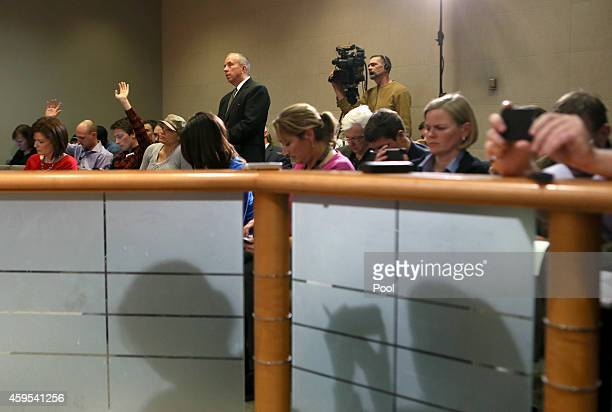 Members of the media attend a press conference hosted by St Louis County Prosecutor Robert McCulloch who announced that the grand jury is not to...