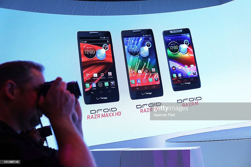 Members of the media attend the launch of three new Motorola smartphones under its Razr brand that will become available for Verizon customers on September 5, 2012 in New York City. The new phones, the Droid Razr HD, the Razr M and the Razr Maxx HD, will all use Google's Android operating system. Motorola Mobility was acquired by Google in August of 2011.