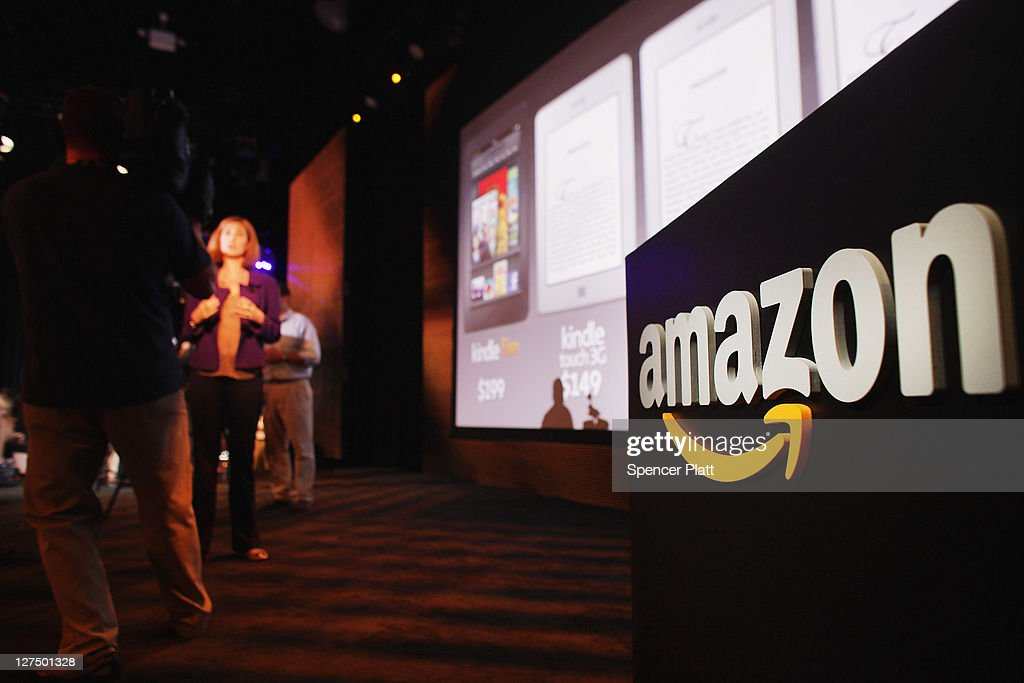 Members of the media cover the launch of the new Amazon tablet called the Kindle Fire on September 28, 2011 in New York City. The Fire, which will be priced at $199, is an expanded version of the company's Kindle e-reader that has 8GB of storage and WiFi. The Fire gives users access to streaming video, as well as e-books, apps and music, and has a Web browser. In addition to the Fire, Bezos introduced four new Kindles including a Kindle touch model.