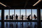 Members of the media explore a model office used to exhibit what a business space could look like on the 63rd floor of One World Trade Center which...