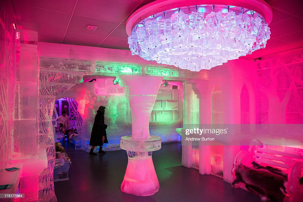 Members of the media explore the interior of Minus5 Ice Bar during a media preview on July 9, 2013 in New York City. The bar, which opened yesterday, is built from 90 tons of ice, kept at 23 degrees Fahrenheit, or minus 5 degrees Celsius, and can hold 55 people.