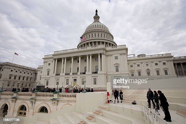 Members of the media film construction of the platform being built on the west front of the US Capitol in preparation for the inauguration ceremony...