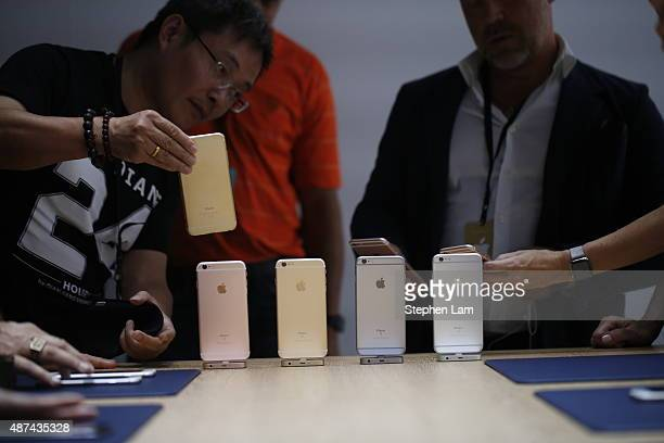 Members of the media gather around a lineup of the new apple iPhone 6s after an Apple special event at Bill Graham Civic Auditorium September 9 2015...