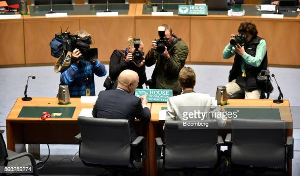 Members of the media gather as Ian Narev chief executive officer of Commonwealth Bank of Australia left and Catherine Livingstone chairman right...