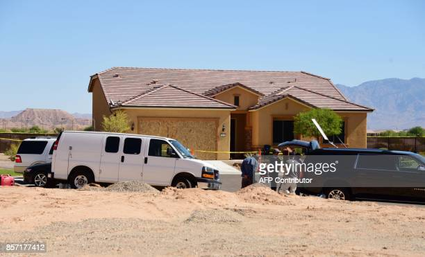 Members of the media gather in front of the home mass murderer Stephen Paddock is seen in Mesquite Nevada October 3 2017 Stephen Paddock killed 59...