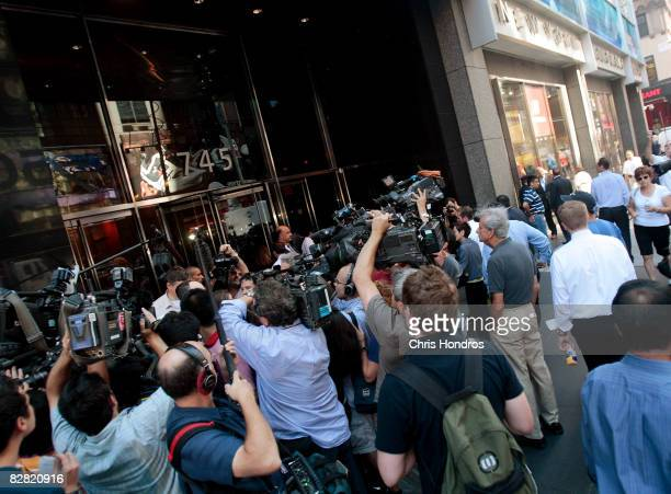 Members of the media gather outside the headquarters of the financial firm Lehman Brothers Holdings Inc September 15 2008 in New York City Lehman...