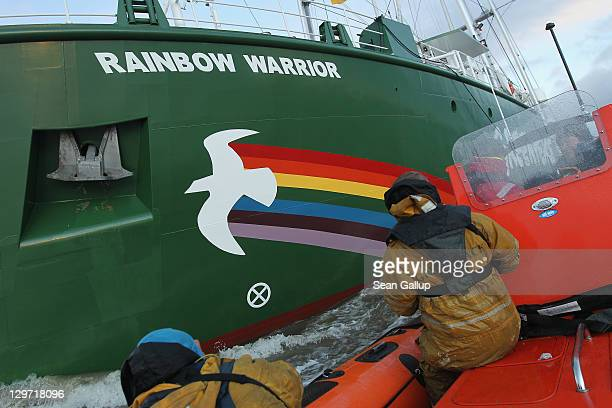 Members of the media in a Greenpeace rubber dinghy photograph the Rainbow Warrior III the newest ship of the enivornmental conservation organization...
