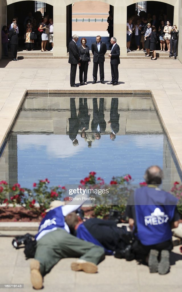 Members of the media lay in wait as the Prime Minister Julia Gillard and Opposition leader Tony Abbott arrive to lay a wreath in honor of fallen Australian soldiers at the Australian War Memorial on February 5, 2013 in Canberra, Australia. Parliament resumes for the first sitting of 2013 today, just days after Prime Minister Gillard, announced a federal election date of September 14, 2013.