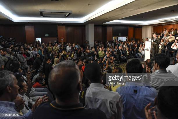 Members of the media listen as Lawmaker Henry Ramos Allup speaks during a press conference held by the opposition coalition announcing the goals of a...