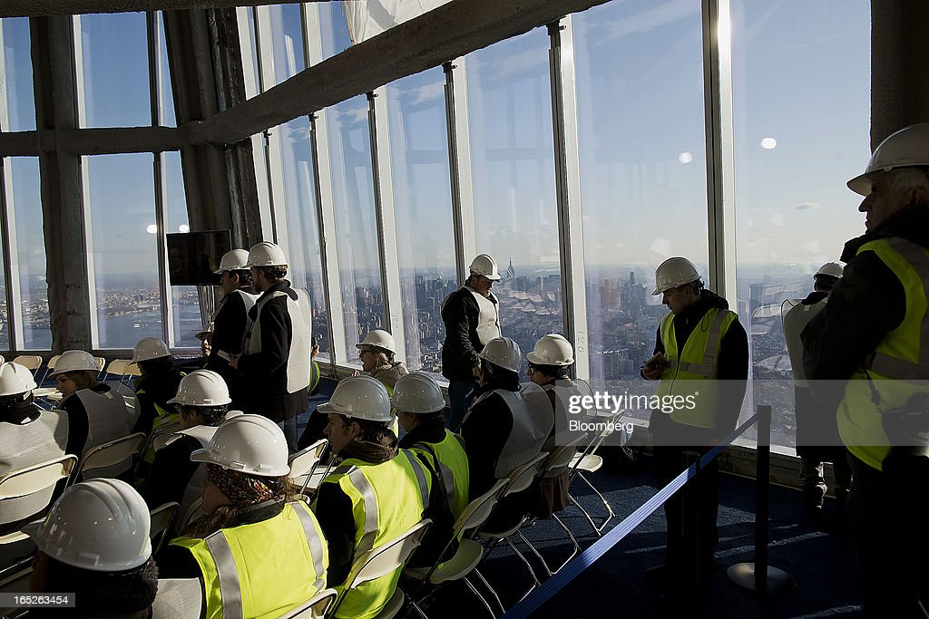 Members of the media listen during a tour of the One World Trade Center observation deck in New York, U.S., on Tuesday, April 2, 2013. The observation deck at One World Trade Center, expected to open in 2015, will occupy the tower's 100th through 102nd floors. Guests visiting the observation deck will see a 'pre-show' about the creation of the building while waiting in line in the lobby. Photographer: Victor J. Blue/Bloomberg via Getty Images