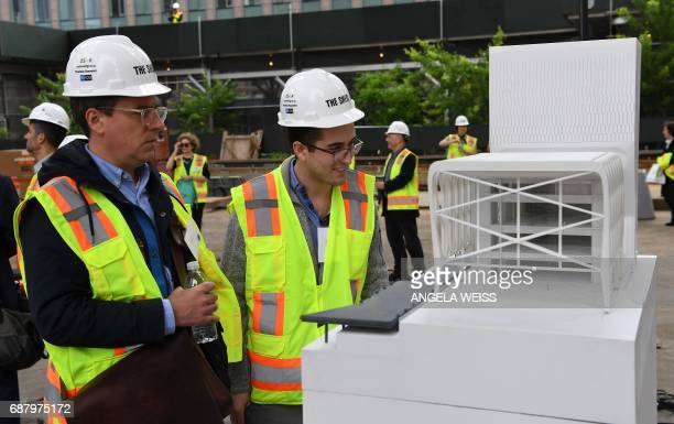 Members of the media look at a model of The Shed New York's new center for artistic invention on May 24 2017 in New York City The facility is...