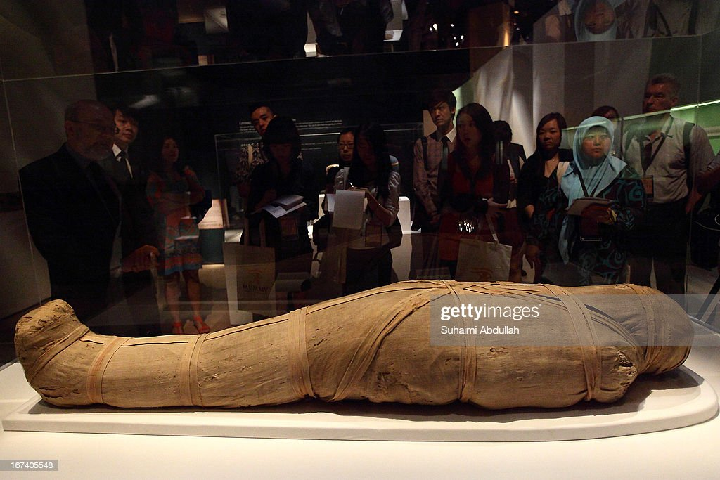 Members of the media look at the Mummy of Shepenmehyt exhibit during a media preview of the Mummy: Secrets of the Tomb exhibition at ArtScience Museum on April 25, 2013 in Singapore. The exhibition includes more than 100 artifacts and six mummies from the heralded ancient Egyptian collection of the British Museum. Among the mummies displayed is the Egyptian temple priest, Nesperennub who lived 3,000 years ago. The exhibition will run from April 27 till November 4, 2013.