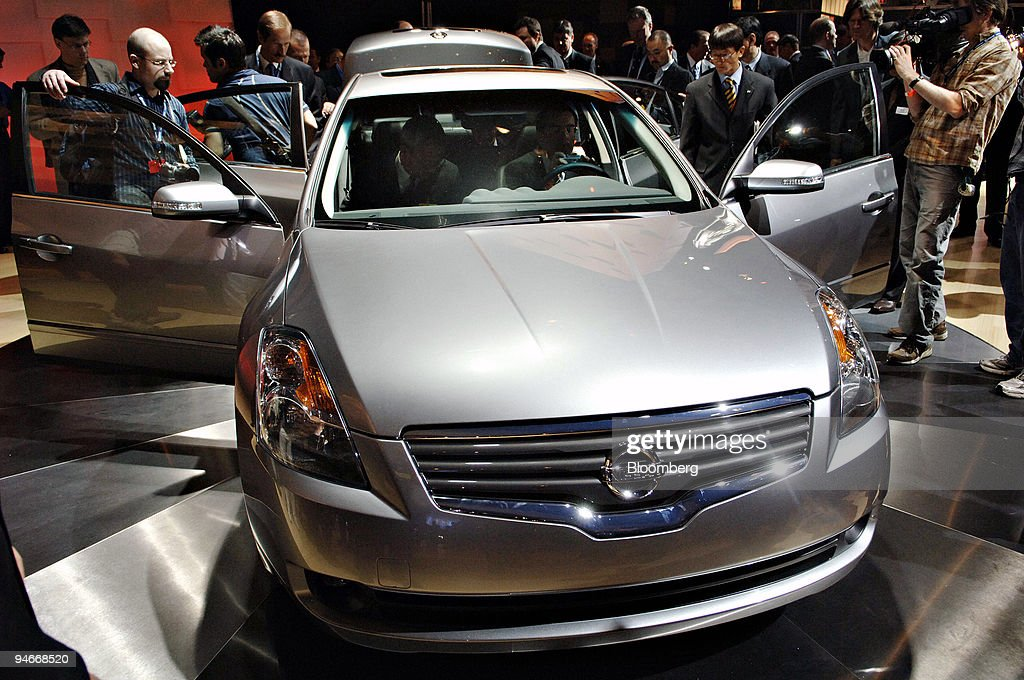 Members of the media look over a 2007 Nissan Altima during the 2006 New York International Auto Show at the Javits Center in New York Wednesday April...