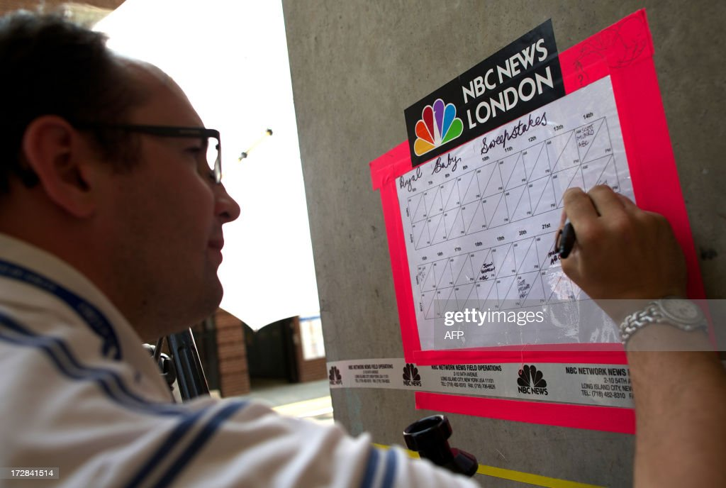 Members of the media mark up their selections for a sweepstake bet on the time, date and sex of Prince William and his wife Catherine's baby outside of the Lindo wing of St Mary's Hospital in London on July 5, 2013. Prince William and his wife Catherine's baby, which will be third in line to the throne, will be born in the private Lindo wing of St Mary's Hospital, where William was born in 1982 and his brother Harry in 1984.