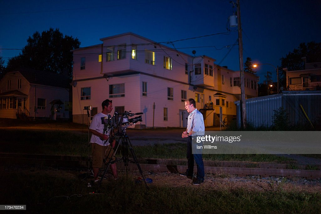 Members of the media, on July 14, 2013 in Lac-Megantic, Quebec, Canada. A train derailed and exploded into a massive fire that flattened dozens of buildings in the town's historic district, leaving 60 people dead or missing in the early morning hours of July 6.