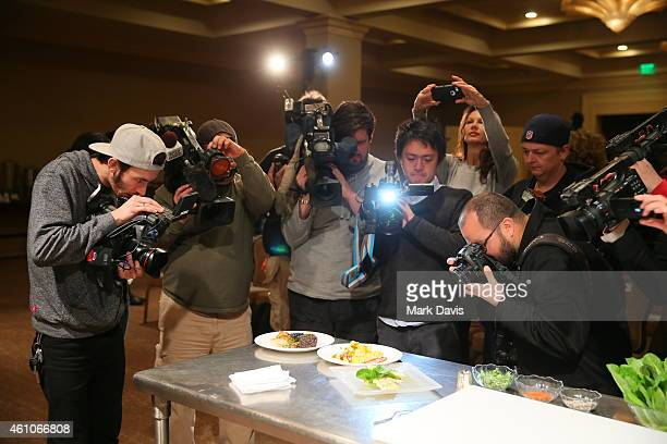 Members of the media photograph and capture food and beverage items as The Beverly Hilton reveals the menu for the 72nd annual Golden Globe awards...