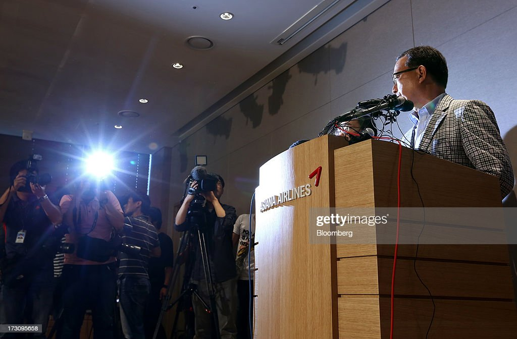 Members of the media photograph and film Yoon Young Doo, chief executive officer and president of Asiana Airlines Inc., as he speaks during a news conference at the company's headquarters in Seoul, South Korea, on Sunday, July 7, 2013. A Boeing Co. 777 flown by South Korea's Asiana Airlines crashed while landing in San Francisco yesterday, killing two people as passengers escaped down emergency slides before a fire swept through the plane. Yoon apologized for the crash and said that Asiana is struggling to confirm details of casualities through the U.S. authorities. Photographer: SeongJoon Cho/Bloomberg via Getty Images