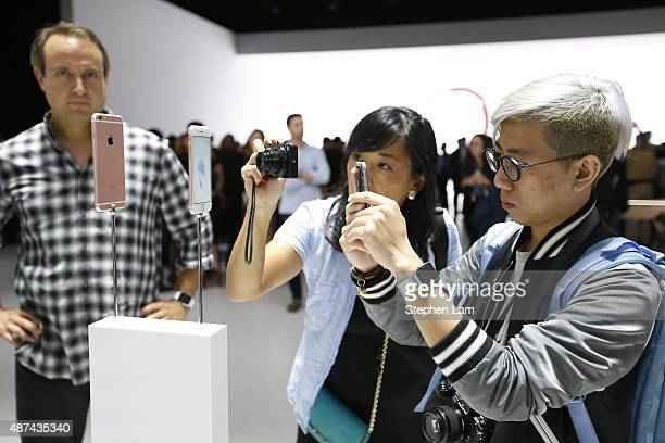 Members of the media photograph the new apple iPhone 6s in rose gold after an Apple special event at Bill Graham Civic Auditorium September 9 2015 in...