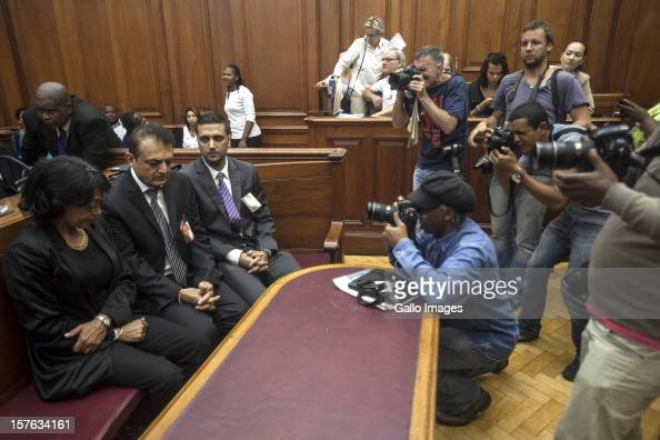 Members of the media photograph Vinod Hindocha father of murdered Anni Dewani ahead of the sentencing of Xolie Mngeni on December 5 2012 in Cape Town...