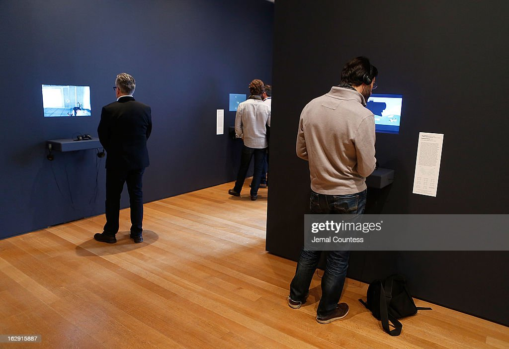 Members of the media play some of the 14 video games that are part of the exhibiton 'Applied Designs' during the 'Applied Design' press preview at The Museum of Modern Art on March 1, 2013 in New York City.