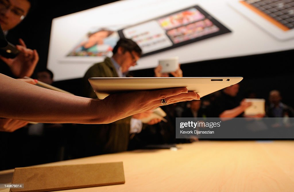 Members of the media preview the new iPad during an Apple product launch event at Yerba Buena Center for the Arts on March 7, 2012 in San Francisco, California. In the first product release following the death of Steve Jobs, Apple Inc. introduced the third version of the iPad and an updated Apple TV.