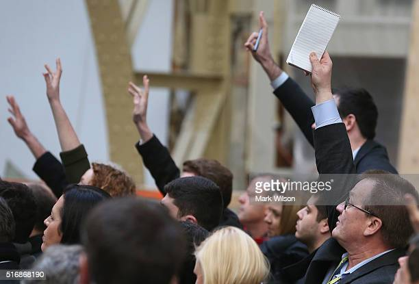 Members of the media raise their hands to ask a question to Republican presidential candidate Donald Trump at the Trump International Hotel that is...