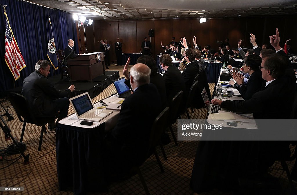 Members of the media raise their hands to ask questions for Federal Reserve Board Chairman Ben Bernanke during a news conference at the Federal Reserve headquarters March 20, 2013 in Washington, DC. Bernanke held a news conference to discuss the U.S. economy and interest rates.