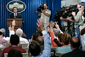 Members of the media raise their hands to ask questions to White House Press Secretary Scott McClellan during the daily news briefing July 12 2005 at...