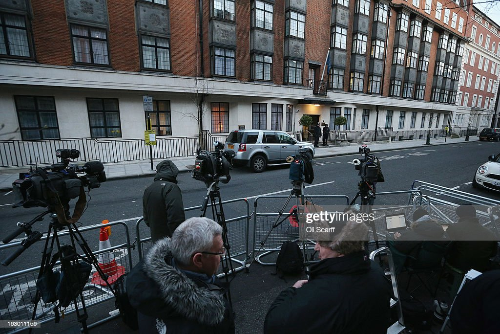 Members of the media report from outside the King Edward VII Hospital where Queen Elizabeth II has been admitted after suffering from symptoms of gastroenteritis on March 3, 2013 in London, England. The 86-year-old monarch is expected to remain in hospital for two days and has cancelled or postponed all official engagements this week, including her trip to Rome.