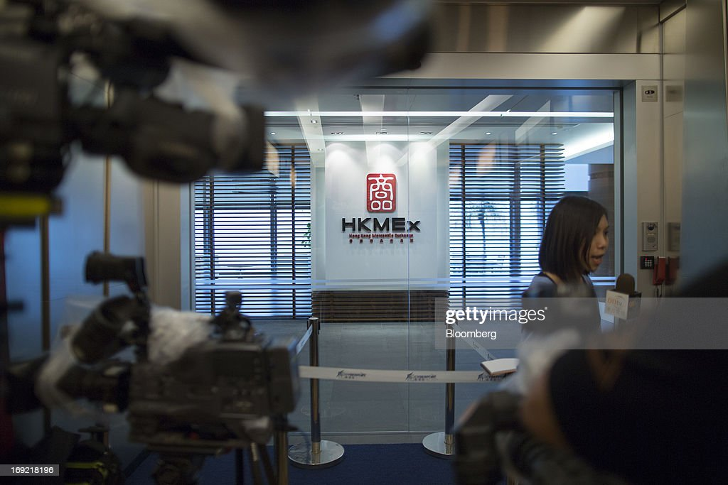 Members of the media report outside the reception area of the Hong Kong Mercantile Exchange Ltd. (HKMEx) offices in Hong Kong, China, on Wednesday, May 22, 2013. Police began probing the Hong Kong Mercantile Exchange, the failed commodities market set up by a member of the city's cabinet, after the securities regulator said it found suspected financial irregularities. Photographer: Jerome Favre/Bloomberg via Getty Images