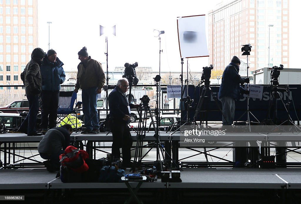 Members of the media set up for election night coverage outside the Boston Convention and Exhibition Center November 5, 2012 in Boston, Massachusetts. U.S. presidential candidate and former Massachusetts Governor Mitt Romney will hold his election night event tomorrow at the venue.
