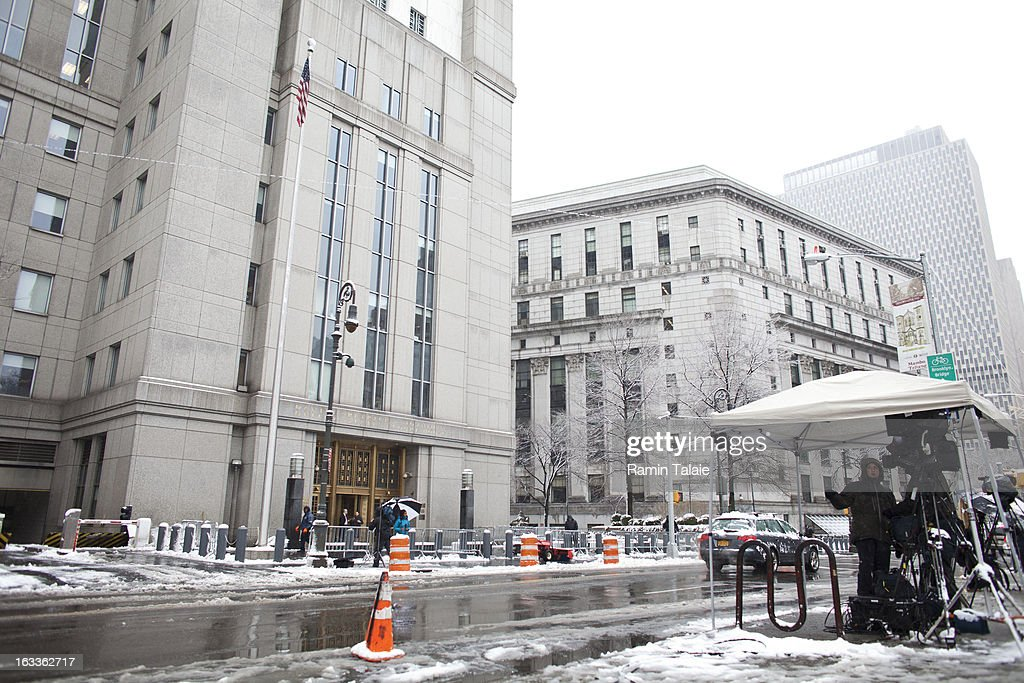 Members of the media stand across the street from the Daniel Patrick Moynihan United States Court House where Sulaiman Abu Ghaith was arraigned on March 8, 2013 in New York City. Abu Ghaith, a son-in-law of Osama bin Laden and former associate, plead not guilty at his arraignment on charges of conspiracy to kill Americans.