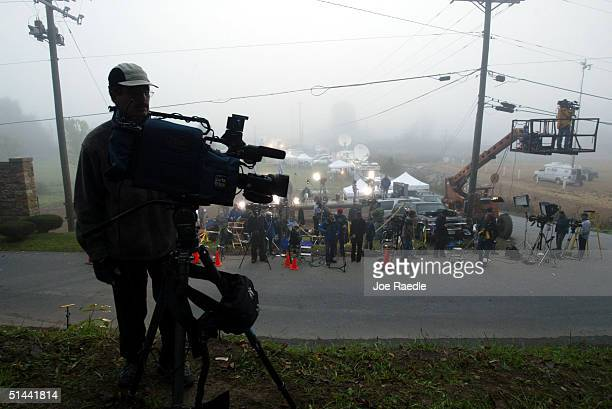 Members of the media stand around the entrance to the Alderson Federal Prison Camp as they wait to hear if Martha Stewart had turned herself in...