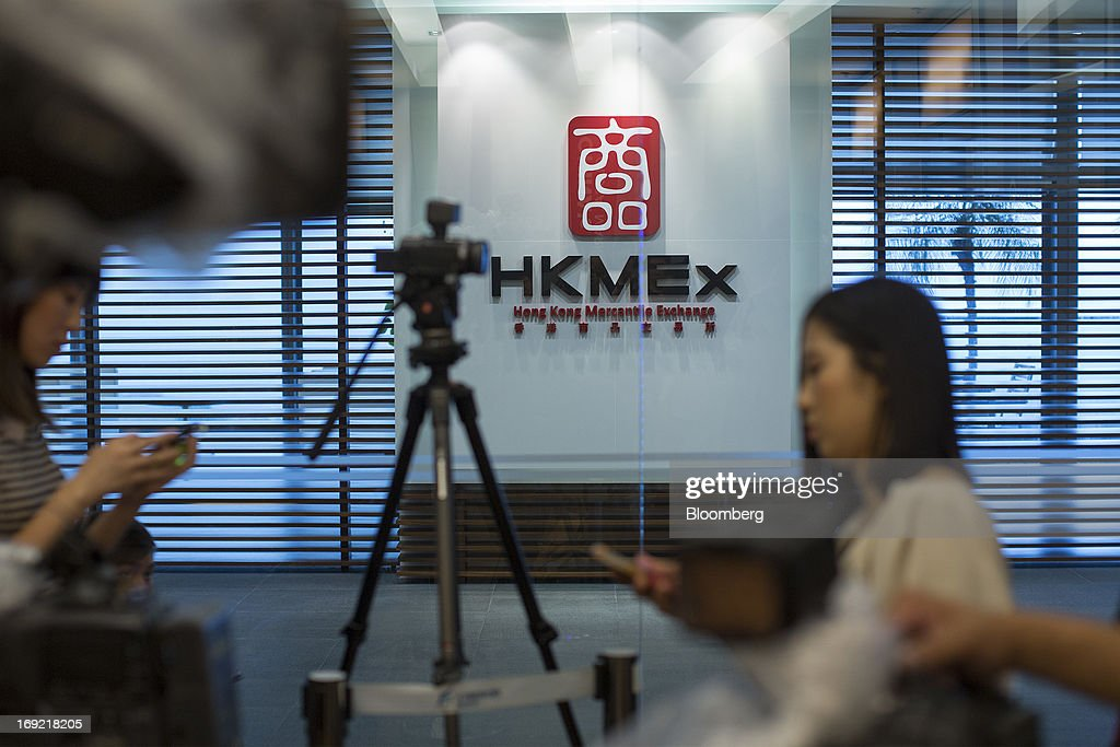 Members of the media stand outside the reception area of the Hong Kong Mercantile Exchange Ltd. (HKMEx) offices in Hong Kong, China, on Wednesday, May 22, 2013. Police began probing the Hong Kong Mercantile Exchange, the failed commodities market set up by a member of the city's cabinet, after the securities regulator said it found suspected financial irregularities. Photographer: Jerome Favre/Bloomberg via Getty Images
