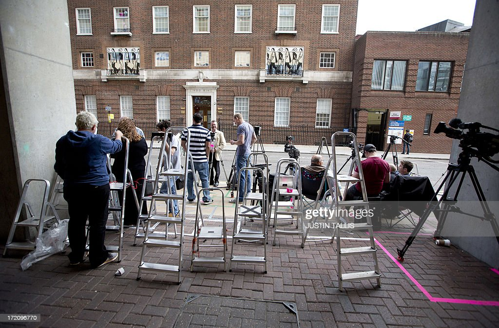 Members of the media start to set up their ladders and tripods outside The Lindo Wing of Saint Mary's Hospital in Paddington, west London on July 1, 2013. Prince William and his wife Catherine's baby, which will be third in line to the throne, will be born in the private Lindo wing of St Mary's Hospital, where William was born in 1982 and his brother Harry in 1984.