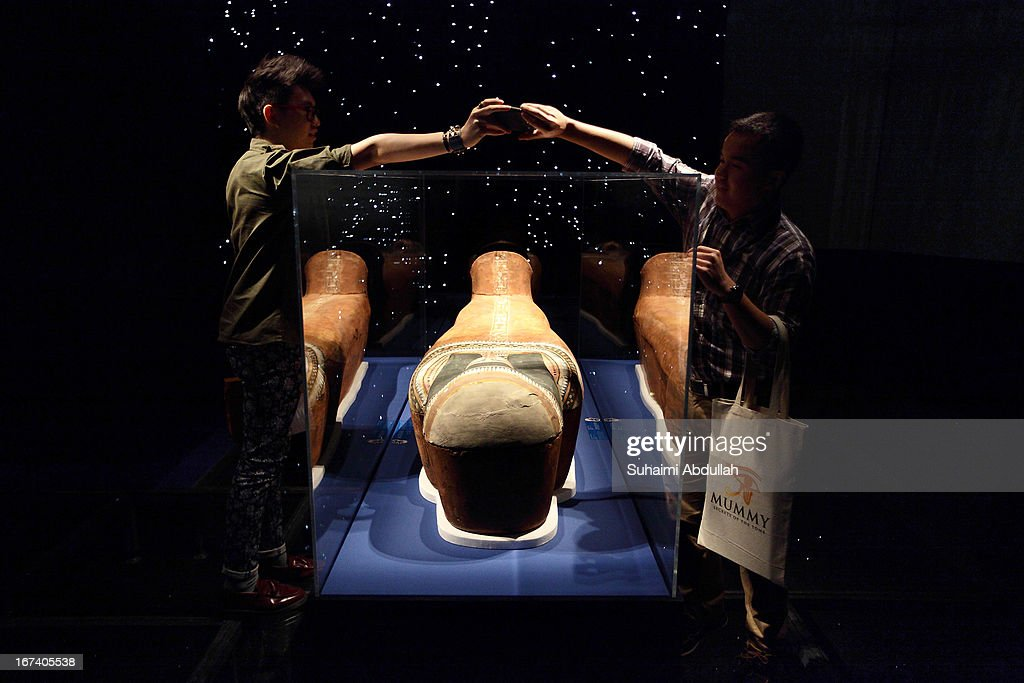 Members of the media take photo of a mummy during a media preview of the Mummy: Secrets of the Tomb exhibition at ArtScience Museum on April 25, 2013 in Singapore. The exhibition includes more than 100 artifacts and six mummies from the heralded ancient Egyptian collection of the British Museum. Among the mummies displayed is the Egyptian temple priest, Nesperennub who lived 3,000 years ago. The exhibition will run from April 27 till November 4, 2013.