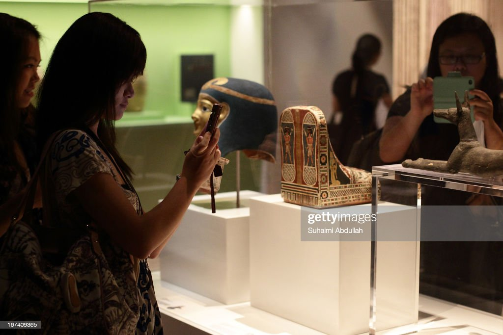 Members of the media take photo of the exhibits during a media preview of the Mummy: Secrets of the Tomb exhibition at ArtScience Museum on April 25, 2013 in Singapore. The exhibition includes more than 100 artifacts and six mummies from the heralded ancient Egyptian collection of the British Museum. Among the mummies displayed is the Egyptian temple priest, Nesperennub who lived 3,000 years ago. The exhibition will run from April 27 till November 4, 2013.