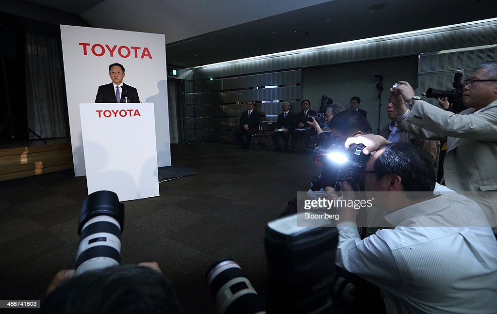Members of the media take photographs of <a gi-track='captionPersonalityLinkClicked' href=/galleries/search?phrase=Akio+Toyoda&family=editorial&specificpeople=2334399 ng-click='$event.stopPropagation()'>Akio Toyoda</a>, president of Toyota Motor Corp., left, speaking during a news conference in Tokyo, Japan, on Thursday, May 8, 2014. Toyota, the world's largest carmaker, forecast profit will fall from last year's record as demand slumps in Japan, competition intensifies in the U.S. and the yen is no longer the boon it used to be. Photographer: Tomohiro Ohsumi/Bloomberg via Getty Images