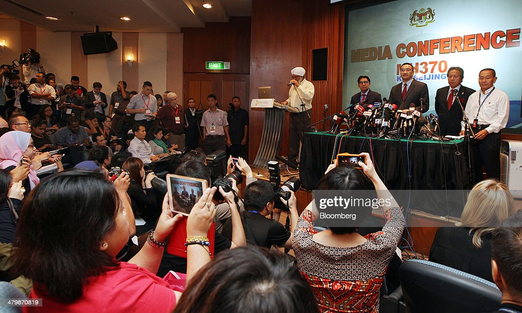 Members of the media take photographs of, from right, <a gi-track='captionPersonalityLinkClicked' href=/galleries/search?phrase=Ahmad+Jauhari+Yahya&family=editorial&specificpeople=9527900 ng-click='$event.stopPropagation()'>Ahmad Jauhari Yahya</a>, chief executive officer of Malaysian Airline System Bhd. (MAS), <a gi-track='captionPersonalityLinkClicked' href=/galleries/search?phrase=Anifah+Aman&family=editorial&specificpeople=5958202 ng-click='$event.stopPropagation()'>Anifah Aman</a>, Malaysia's minister of foreign affairs, Hishammuddin Hussein, Malaysia's acting transport minister, and Azharuddin Abdul Rahman, director general of Malaysia's Department of Civil Aviation, as they stand at a news conference in Sepang, Malaysia, on Thursday, March 20, 2014. Aircraft sent to check whether objects spotted by satellite in the southern Indian Ocean belong to the missing Malaysian passenger jet returned without making any sightings, as the search stretched into the 13th day. Photographer: Goh Seng Chong/Bloomberg via Getty Images