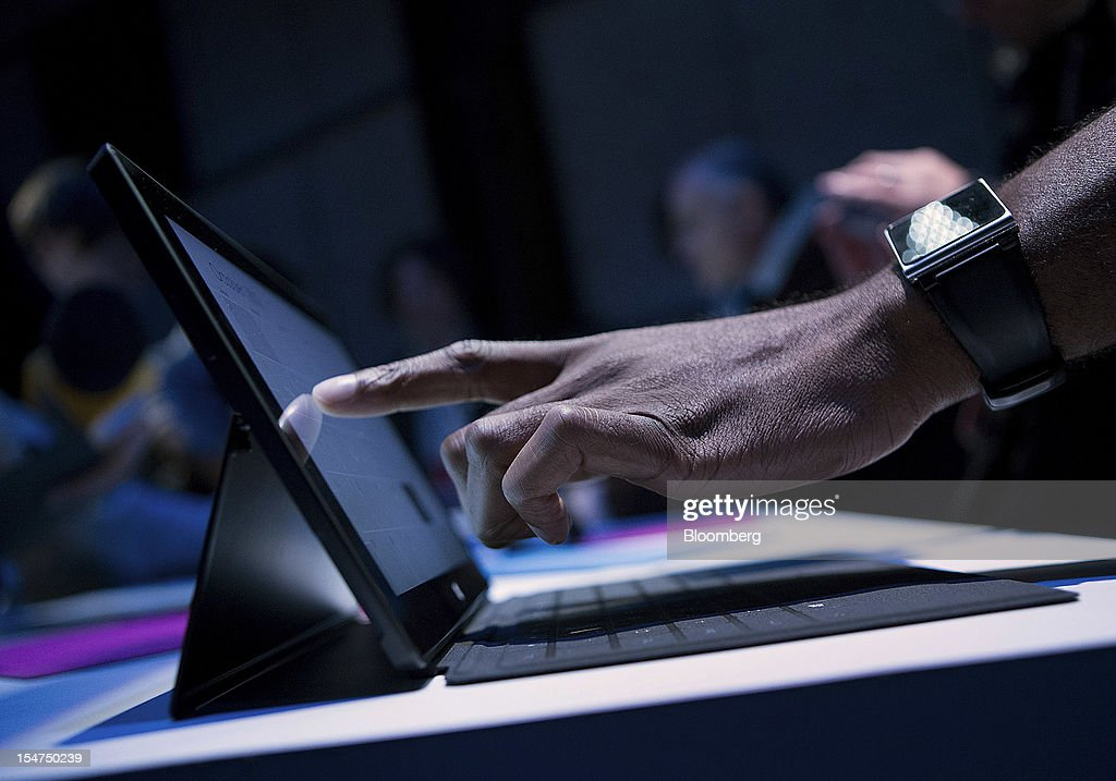 Members of the media test Microsoft Corp. Surface tablet computers during an event in New York, U.S., on Thursday, Oct. 25, 2012. Microsoft Corp. will be constrained in a contest against Apple Inc. in the market for handheld computers by unveiling a tablet that doesn't work with some of the most widely used downloadable applications. Photographer: Scott Eells/Bloomberg via Getty Images