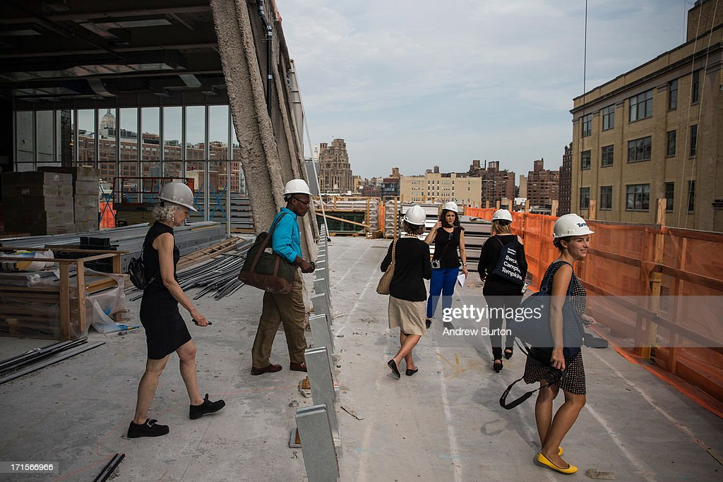 Members of the media tour the Whitney Museum of American Art's new building, which is still under construction, on June 26, 2013 in the Meat Packing District neighborhood of New York City. The museum, which is scheduled to open in 2015, will be nine stories tall and was designed by Renzo Piano Building Workshops. The estimated capital campaign, including building cost, endowments and the increase of instituional capacity, is $760 million.