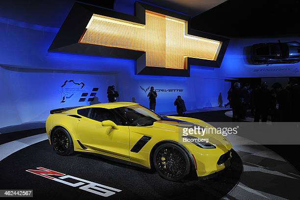 Members of the media view the Chevrolet Corvette Z06 displayed during the the 2014 North American International Auto Show in Detroit Michigan US on...