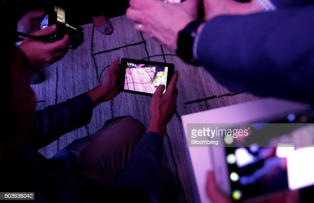 Members of the media view the Project Tango Development Kit during a Google Inc and Lenovo Group Ltd event at the 2016 Consumer Electronics Show in...