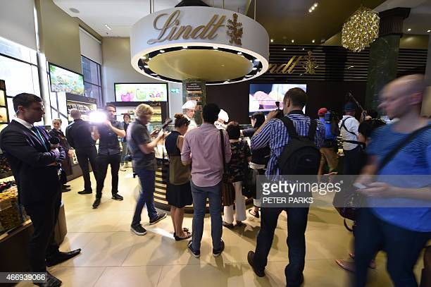 Members of the media visit the Lindt Cafe at Martin Place in Sydney ahead of the reopening on March 20 2015 The Lindt cafe opened three months after...