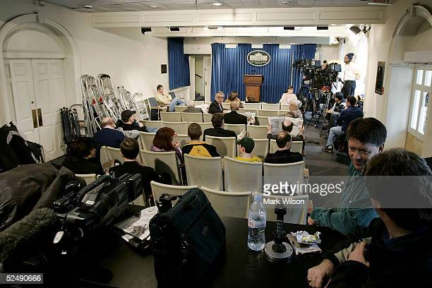 Members of the media wait for the start of the daily briefing by White House press secretary Scott McClellan in the briefing room that is located in...
