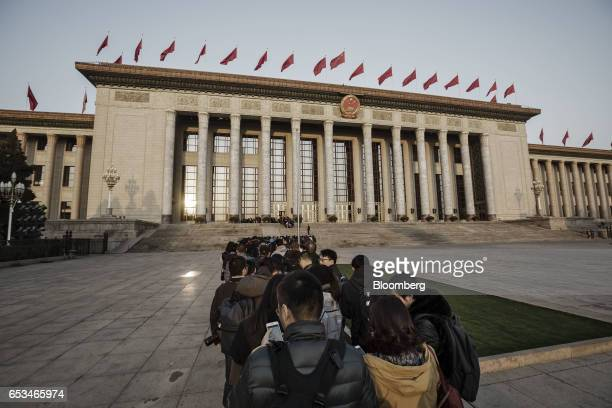 Members of the media wait in line outside of the Great Hall of the People for the closing ceremony of the National People's Congress in Beijing China...